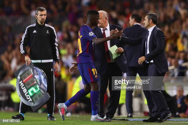 Ernesto Valverde Head Coach of FC Barcelona shakes hands with Ousmane Dembele of FC Barcelona at a substitution during the UEFA Champions League...