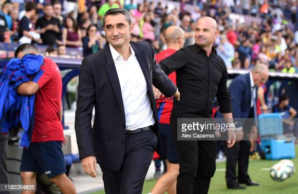 Ernesto Valverde manager of Barcelona and Paco Lopez Manager of Levante UD greet each other prior to the Liga match between Levante UD and FC...