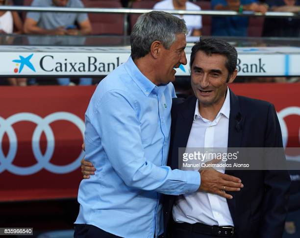 Ernesto Valverde , Manager of Barcelona greets Quique Setien, Manager of Betis prior to the La Liga match between Barcelona and Real Betis at Camp...