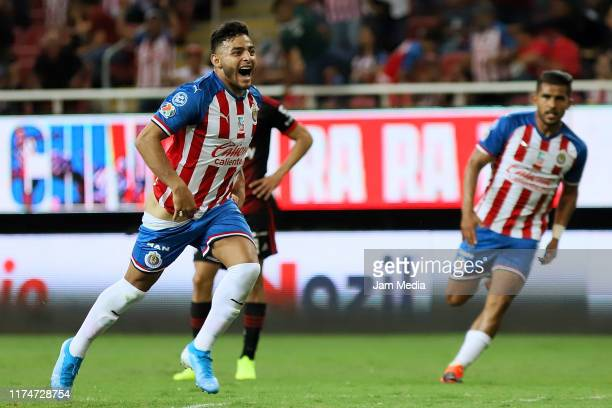 Ernesto Vega of Chivas celebrates after scoring the first goal of his team during the 9th round match between Chivas and Atlas as part of the Torneo...