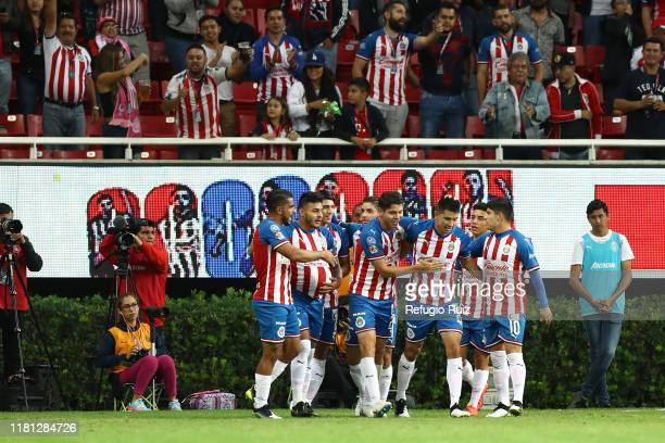 Ernesto Vega of Chivas celebrates with his teammates after scoring the first goal of his team during the 18th round match between Chivas and...