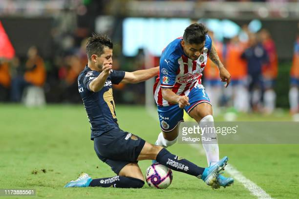 Ernesto Vega of Chivas fights for the ball with Alan Mozo of Pumas during the 13th round match between Chivas and Pumas UNAM as part of the Torneo...