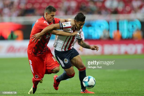 Ernesto Vega of Chivas fights for the ball with Lampros Kontogiannis of Veracruz during the fifth round match between Chivas and Veracruz as part of...