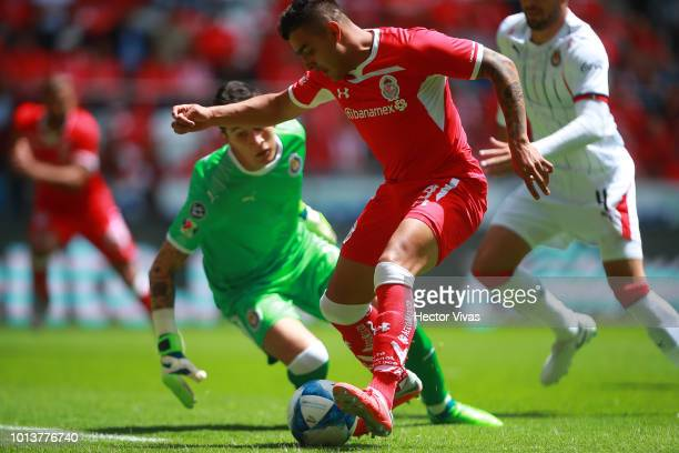 Ernesto Vega of Toluca scores the first goal of his team during the third round match between Toluca and Chivas as part of the Torneo Apertura 2018...