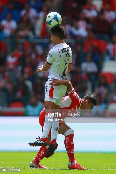 Ernesto Vega of Toluca struggles for the ball with Josecarlos Van Rankin of Chivas during the third round match between Toluca and Chivas as part of...