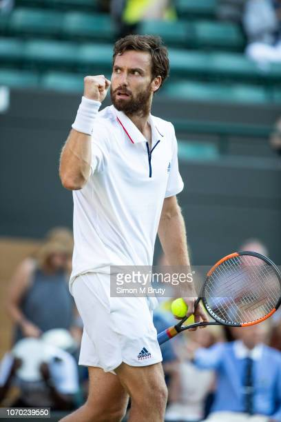 Ernests Gulbis of Lativa in action against Alexander Zverev of Germany during The Wimbledon Lawn Tennis Championship at the All England Lawn Tennis...