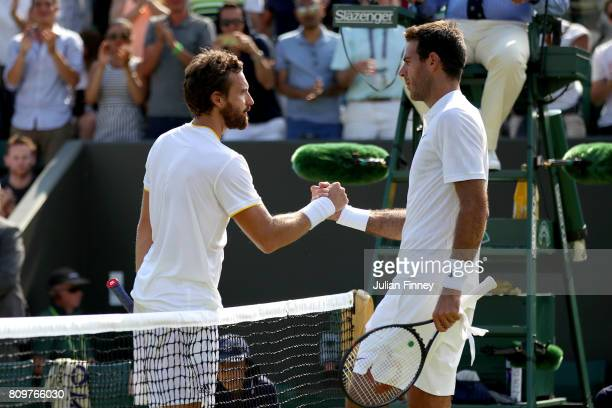 Ernests Gulbis of Latvia and Juan Martin Del Potro of Argentina shake hands after their Gentlemen's Singles second round match on day four of the...