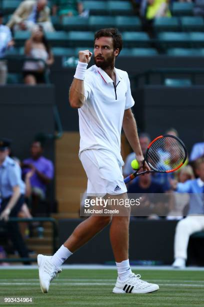 Ernests Gulbis of Latvia celebrates after defeating Alexander Zverev of Germany in their Men's Singles third round match on day six of the Wimbledon...