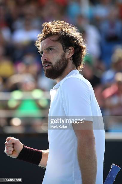 Ernests Gulbis of Latvia celebrates after winning a point during his Men's Singles first round match against Felix AugerAliassime of Canada on day...