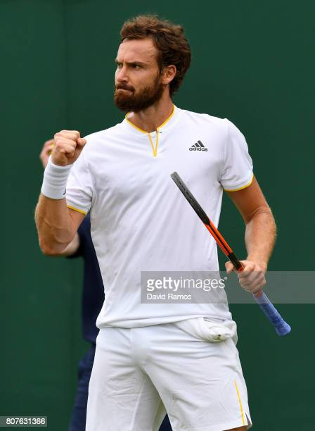 Ernests Gulbis of Latvia celebrates during the Gentlemen's Singles first round match against Victor Estrella Burgos of The Dominican Republic on day...