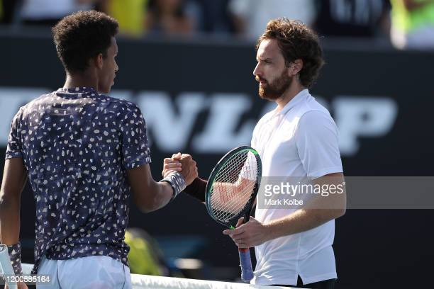 Ernests Gulbis of Latvia celebrates winning match point during his Men's Singles first round match against Felix AugerAliassime of Canada on day two...