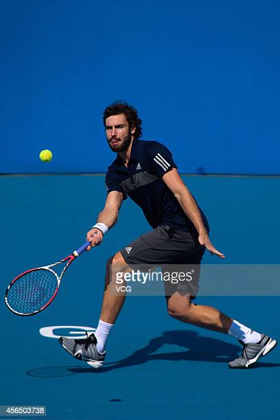 Ernests Gulbis of Latvia competes with Martin Klizan of Slovakia at National Tennis Centre in day 6 of 2014 China Open on October 2 2014 in Beijing...