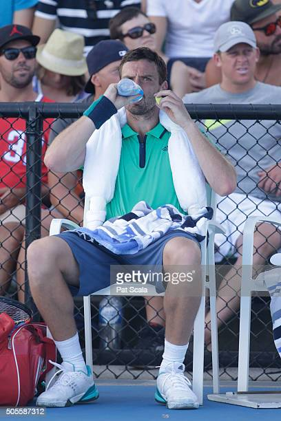 Ernests Gulbis of Latvia has a drink during a break in play in his first round match against Jeremy Chardy of France during day two of the 2016...