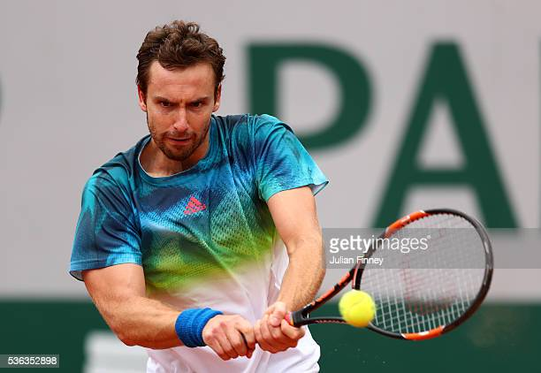Ernests Gulbis of Latvia hits a backhand during the Men's Singles fourth round match against David Goffin of Belgium on day eleven of the 2016 French...