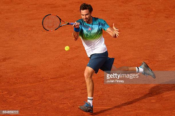 Ernests Gulbis of Latvia hits a forehand during the Men's Singles third round match against JoWilfried Tsonga of France on day seven of the 2016...