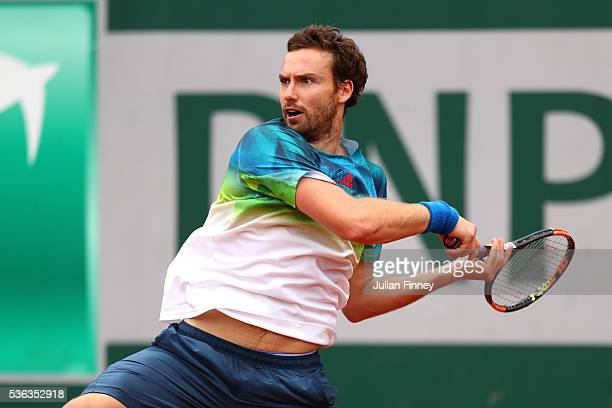Ernests Gulbis of Latvia hits a forehand during the Men's Singles fourth round match against David Goffin of Belgium on day eleven of the 2016 French...