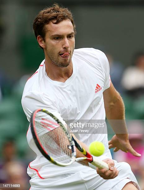 Ernests Gulbis of Latvia hits a forehand return during his gentlemen's singles first round match against Tomas Berdych of Czech Republic on day one...
