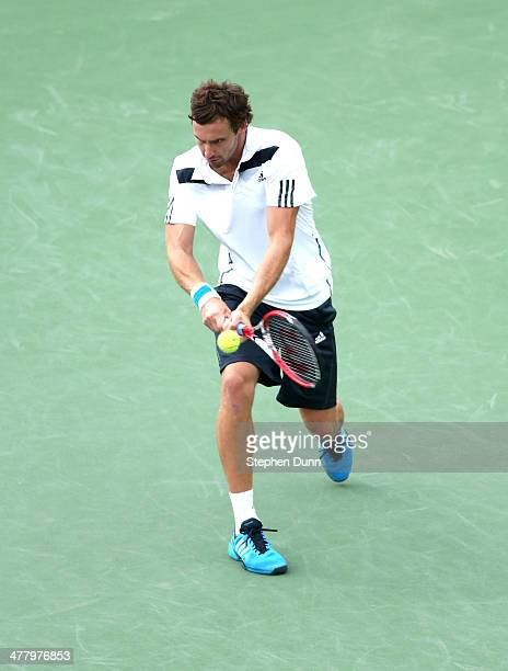 Ernests Gulbis of Latvia hits a return to Grigor Dimitrov of Bulgara during the BNP Paribas Open at Indian Wells Tennis Garden on March 9 2014 in...
