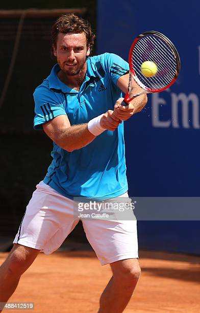 Ernests Gulbis of Latvia in action against Albert Montanes of Spain during day four of the ATP Tour Open Banc Sabadell Barcelona 2014 62nd Trofeo...