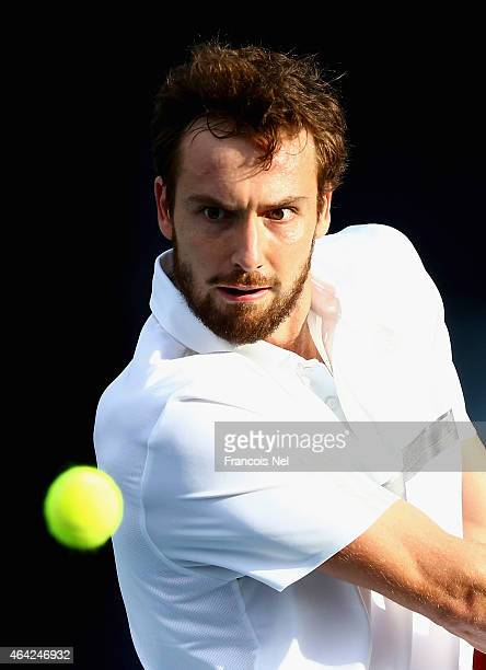 Ernests Gulbis of Latvia in action against Denis Istomin of Uzbekistan during day one of the ATP Dubai Duty Free Tennis Championships at the Dubai...
