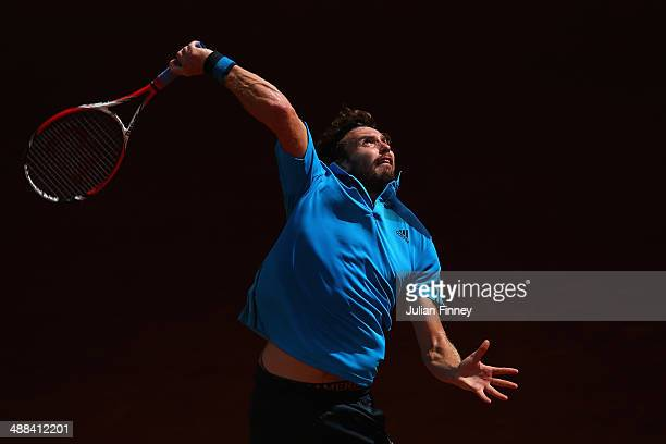 Ernests Gulbis of Latvia in action against Jerzy Janowicz of Poland during day four of the Mutua Madrid Open tennis tournament at the Caja Magica on...