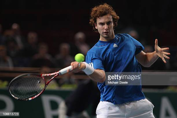 Ernests Gulbis of Latvia in action during his match against Juan Ignacio Chela of during Day One of the ATP Masters Series Paris at the Palais...