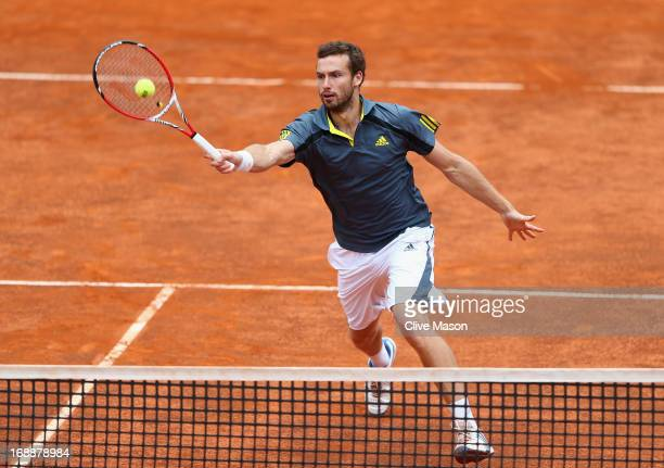 Ernests Gulbis of Latvia in action during his third round match against Rafael Nadal of Spain on day five of the Internazionali BNL d'Italia 2013 at...