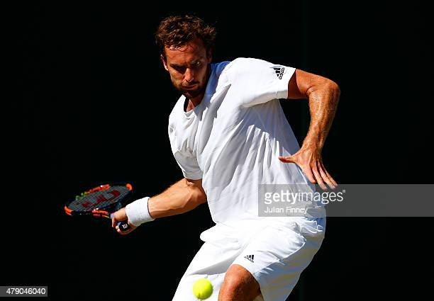 Ernests Gulbis of Latvia in action in his Gentlemen's Singles first round match against Lukas Rosol of Czech Republic during day two of the Wimbledon...