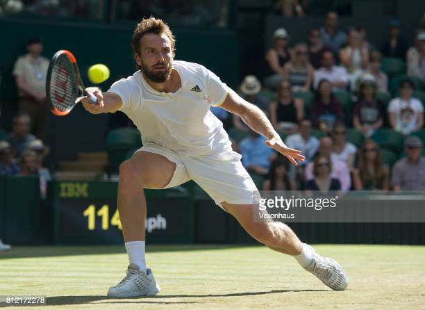 Ernests Gulbis of Latvia is action during the Gentlemen's Singles third round match against Novak Djokovic on day six of the Wimbledon Lawn Tennis...