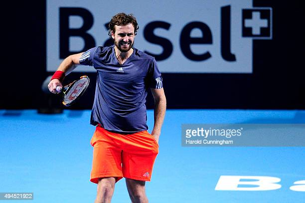 Ernests Gulbis of Latvia looks dejected as he misses a point during the second day of the Swiss Indoors ATP 500 tennis tournament against John Isner...