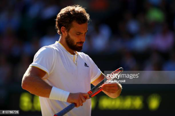 Ernests Gulbis of Latvia looks on during the Gentlemen's Singles third round match against Novak Djokovic of Serbia on day six of the Wimbledon Lawn...