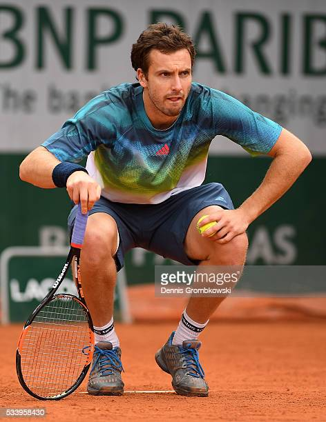 Ernests Gulbis of Latvia looks on during the Men's Singles first round match against Andreas Seppi of Italy on day three of the 2016 French Open at...