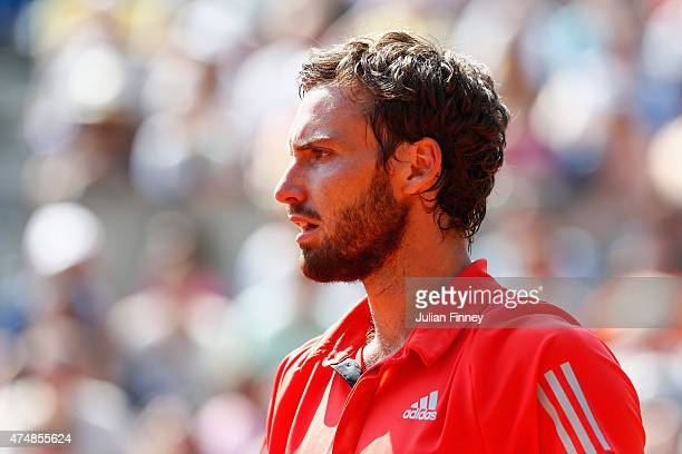 Ernests Gulbis of Latvia looks on in his Men's Singles match against Nicolas Mahut of France during day four of the 2015 French Open at Roland Garros...