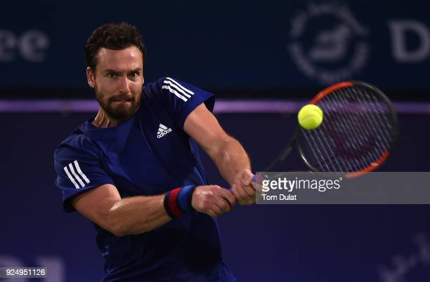 Ernests Gulbis of Latvia plays a backhand during his match against Lucas Pouille of France on day two of the ATP Dubai Duty Free Tennis Championships...