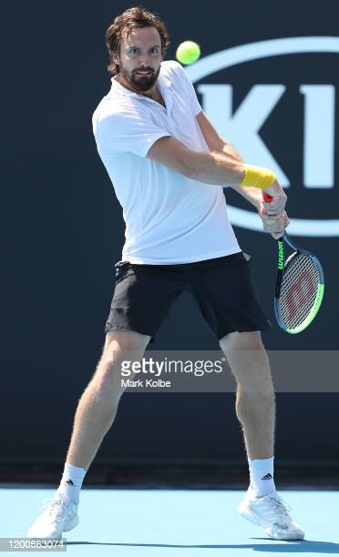 Ernests Gulbis of Latvia plays a backhand during his Men's Singles first round match against Felix AugerAliassime of Canada on day two of the 2020...