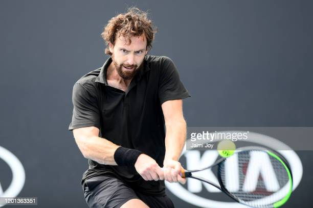 Ernests Gulbis of Latvia plays a backhand during his Men's Singles second round match against Aljaz Bedene of Slovenia on day four of the 2020...