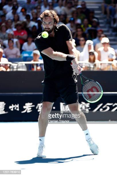 Ernests Gulbis of Latvia plays a backhand during his Men's Singles third round match against Gael Monfils of France on day six of the 2020 Australian...