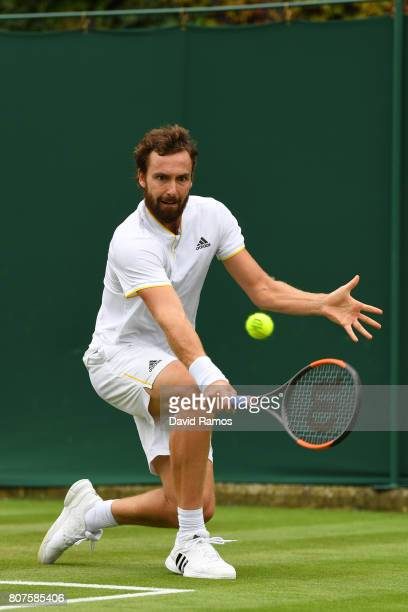 Ernests Gulbis of Latvia plays a backhand during the Gentlemen's Singles first round match against Victor Estrella Burgos of The Dominican Republic...