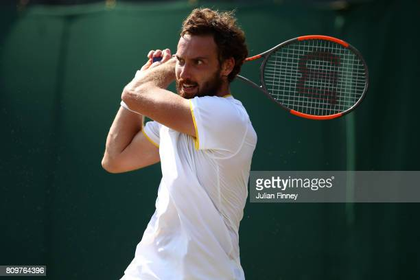 Ernests Gulbis of Latvia plays a backhand during the Gentlemen's Singles second round match against Juan Martin Del Potro of Argentina on day four of...