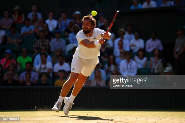 Ernests Gulbis of Latvia plays a backhand during the Gentlemen's Singles third round match against Novak Djokovic of Serbia on day six of the...