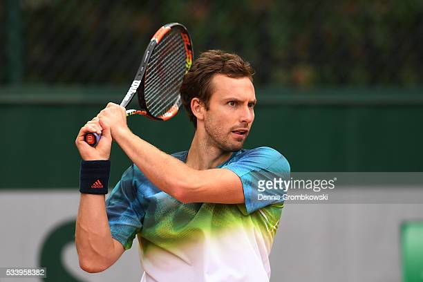 Ernests Gulbis of Latvia plays a backhand during the Men's Singles first round match against Andreas Seppi of Italy on day three of the 2016 French...