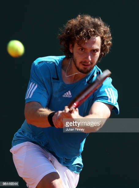 Ernests Gulbis of Latvia plays a backhand in his match against Stanislas Wawrinka of Switzerland during day three of the ATP Masters Series at the...