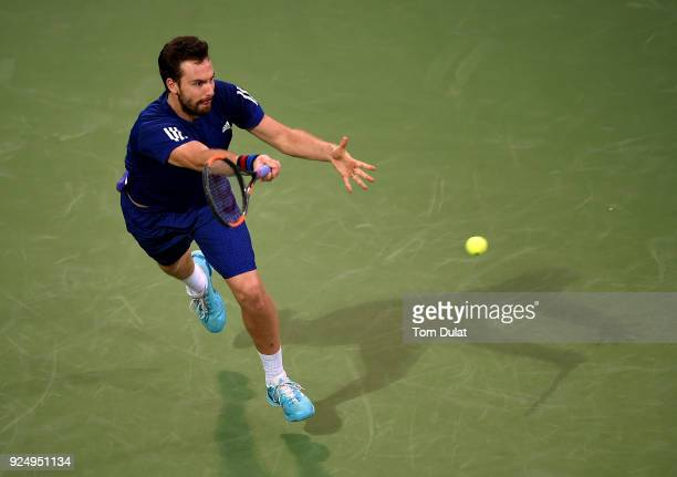 Ernests Gulbis of Latvia plays a forehand during his match against Lucas Pouille of France on day two of the ATP Dubai Duty Free Tennis Championships...