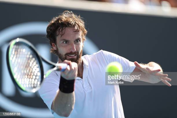 Ernests Gulbis of Latvia plays a forehand during his Men's Singles first round match against Felix AugerAliassime of Canada on day two of the 2020...