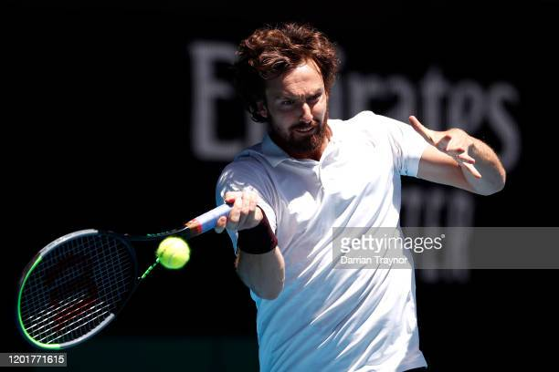 Ernests Gulbis of Latvia plays a forehand during his Men's Singles third round match against Gael Monfils of France on day six of the 2020 Australian...
