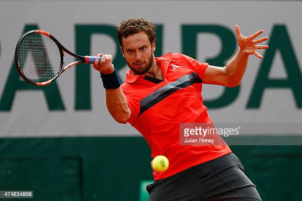 Ernests Gulbis of Latvia plays a forehand during his Men's Singles match against Igor Sijsling of Netherlands on day one of the 2015 French Open at...