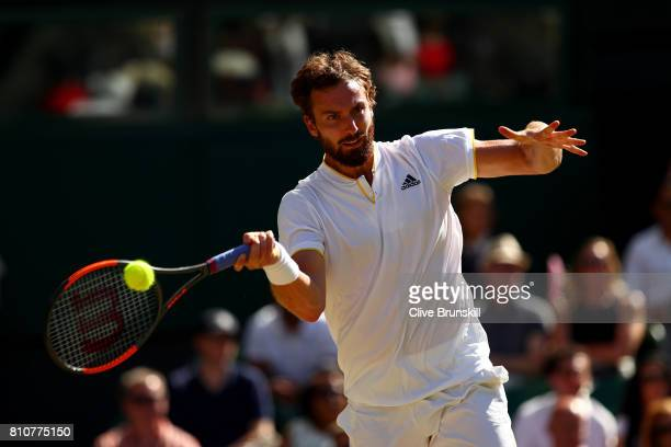 Ernests Gulbis of Latvia plays a forehand during the Gentlemen's Singles third round match against Novak Djokovic of Serbia on day six of the...