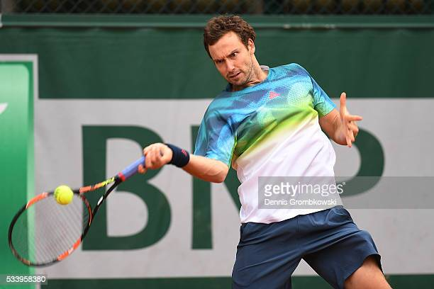Ernests Gulbis of Latvia plays a forehand during the Men's Singles first round match against Andreas Seppi of Italy on day three of the 2016 French...