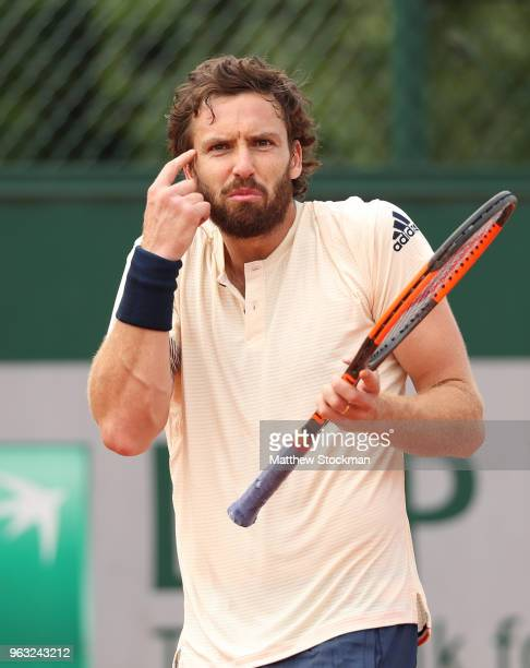 Ernests Gulbis of Latvia reacts during the mens singles first round match against Gilles Muller of Luxembourg during day two of the 2018 French Open...