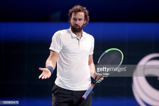 Ernests Gulbis of Latvia reacts in his Men's Singles first round match against Roberto Marcora of Italy on day three of the Singapore Tennis Open at...